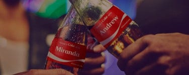 two people enjoying Coca-Cola